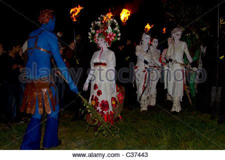 The May Queen and her White Women lead procession on