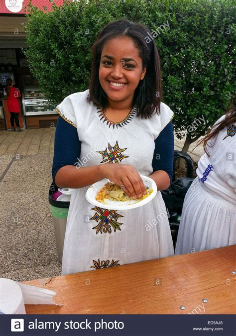 Young Ethiopian Jew in traditional dress and a plate of