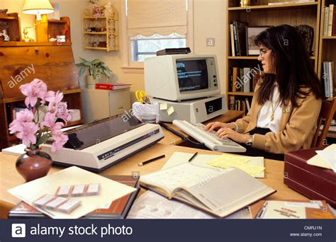 1980s 1990s FREELANCE WOMAN WORKING ON EARLY IBM PC ON